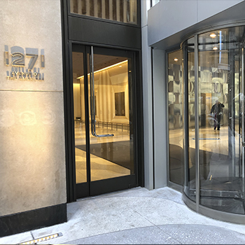 1271 Avenue of the Amercias Curved glass entrance nyc